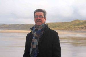 Dr Herring on Thorntonloch Beach where the whales stranded